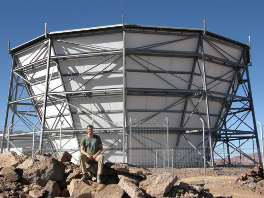 Jon Ward '13 working at a telescope in the Andes mountains.