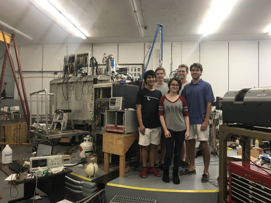 Jessica Nebel-Crosson (UC '21) and collaborators in front of the Enge split-pole spectrograph (SPS) at the Fox Superconducting Linear Accelerator Laboratory at Florida State University in summer of 2019.