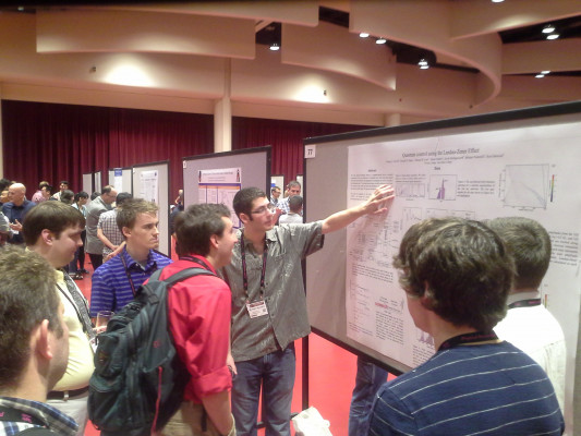 Mike Vennettilli explains his research at DAMOP 2015 in Madison, WI.