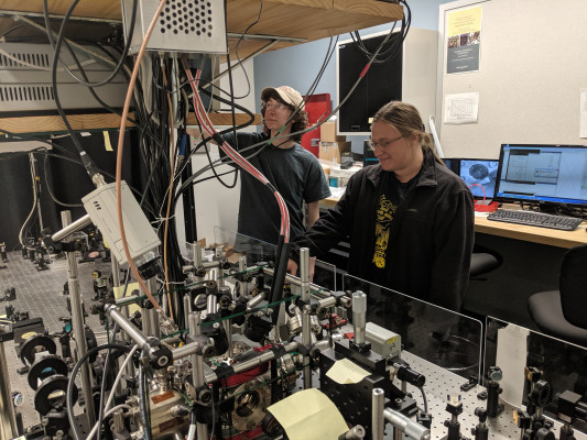 Briana Strickland and Marty Dryfoos work in the ultracold atomic physics lab at Bryn Mawr College in 2019.
