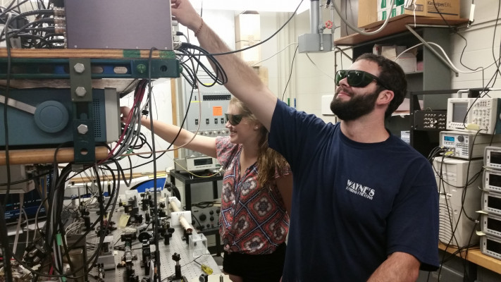 Veronica Sanford and Jacob Bigelow work in the ultracold atomic physics lab at Bryn Mawr College.