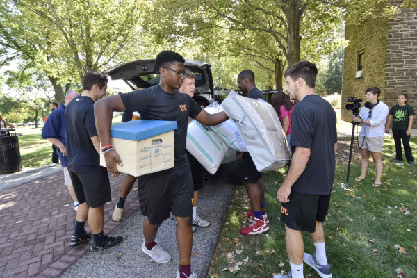 Members of the Ursinus football team helped with the heavy lifting.