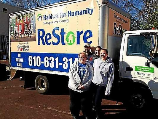 ReStore staff members Kathy Walsh, left, Brian Gillen, Abby Rambo and Erika Reinhard stand outsid...
