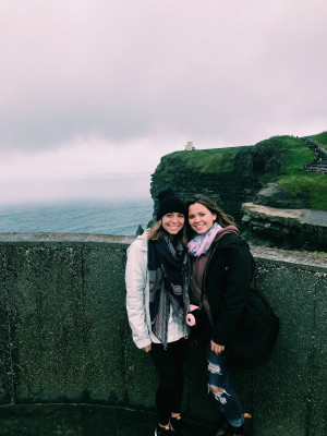 Students posing at the Cliffs of Moher in Ireland