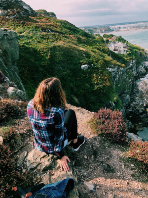Student on a cliff in Ireland