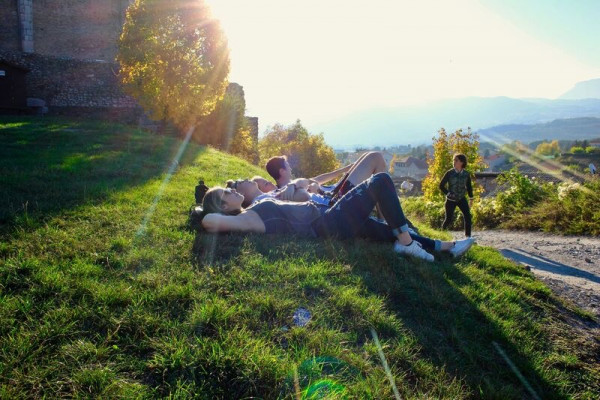 Students laying in the grass in France