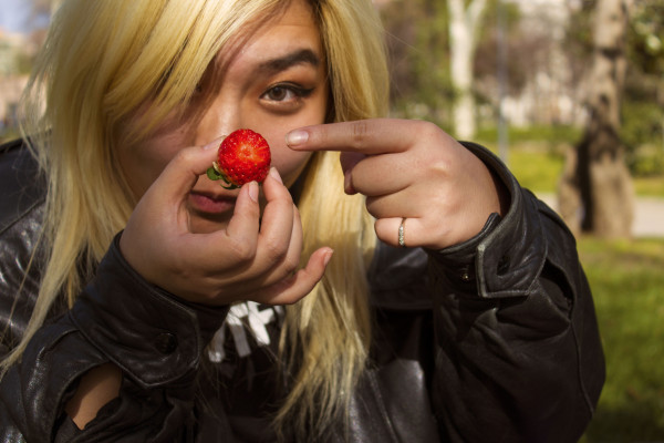 Student holding a strawberry in Spain